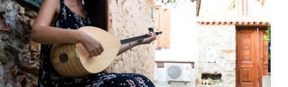 A young woman plays the saz